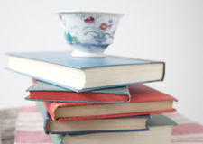 pile-used-books-teacup-old-cup-top-stack-36567279